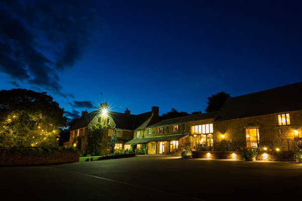 Crockwell Farm wedding venue in Northamptonshire lit up in the evening | CHWV