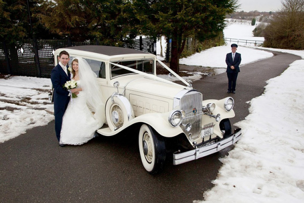 The bride and groom arrive in style at Crondon Park Barn wedding venue in Essex | CHWV