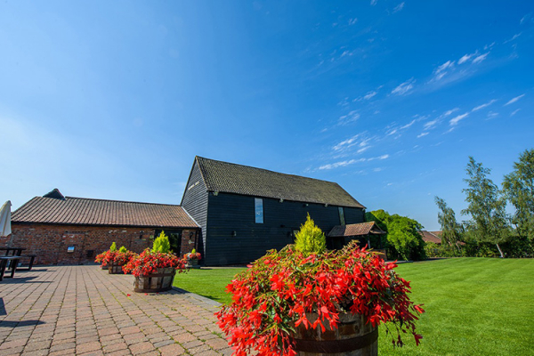 The barn in the sunshine at Crondon Park Barn wedding venue in Essex | CHWV