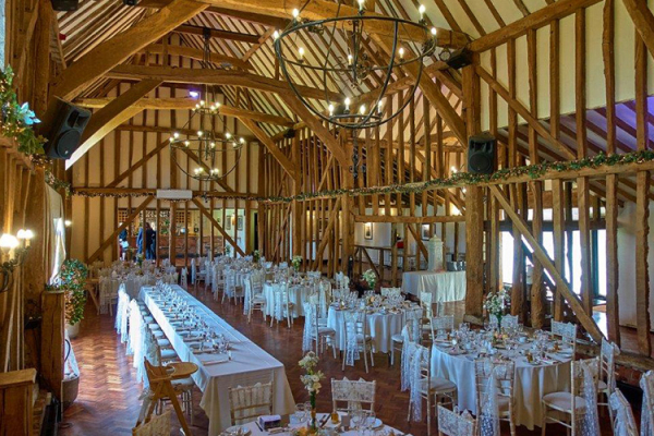 The barn set up for a wedding breakfast at Crondon Park Barn wedding venue in Essex | CHWV
