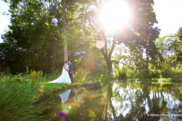 A happy couple exploring the grounds at Crowcombe Court in Somerset | CHWV