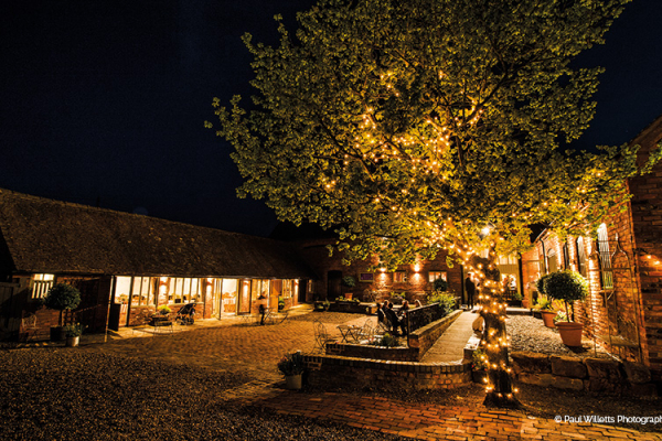 The courtyard in the evening at Curradine Barns wedding venue in Worcestershire | CHWV