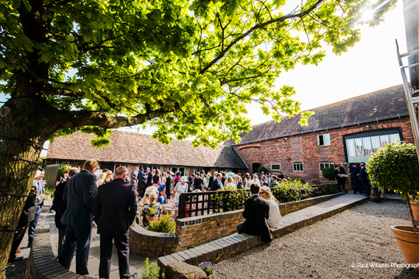 A drinks reception in the courtyard at Curradine Barns wedding venue in Worcestershire | CHWV