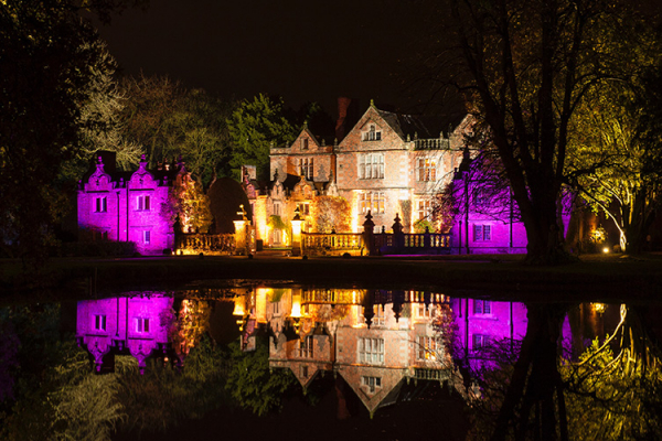 The hall lit up in the evening at Dorfold Hall wedding venue in Cheshire | CHWV