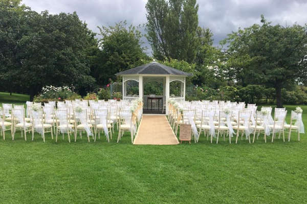 Set up for an outfoor wedding ceremony at Fennes country house wedding venue in Essex | CHWV