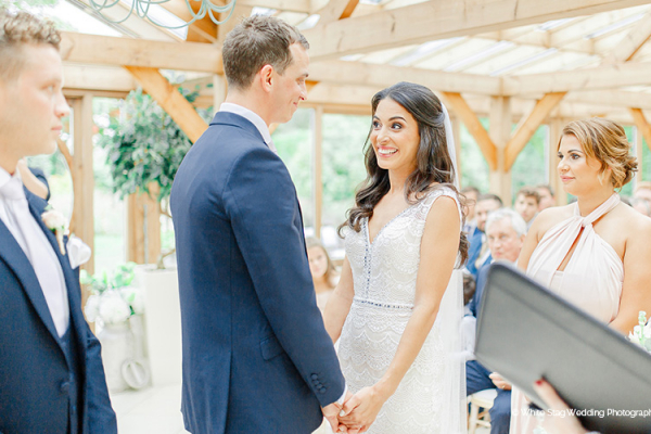 A wedding ceremony in The Orangery at Gaynes Park barn wedding venue in Essex | CHWV