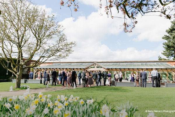 A drinks reception outside The Orangery at Gaynes Park barn wedding venue in Essex | CHWV