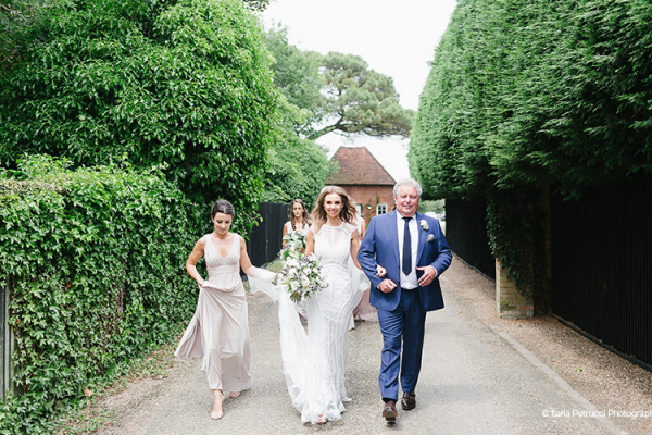 A bride with her father at Gaynes Park barn wedding venue in Essex | CHWV
