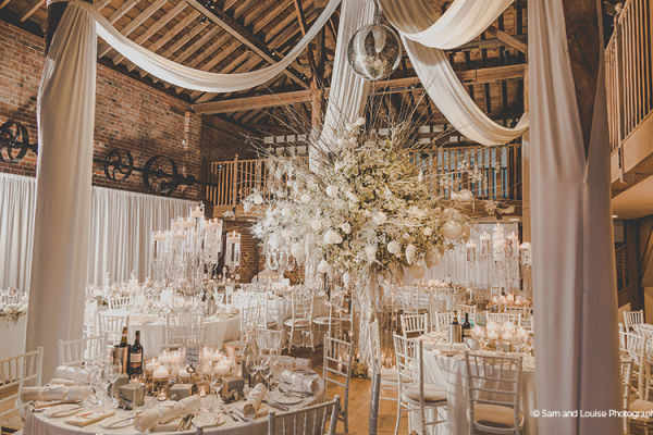 The Mill Barn decorated for a wedding breakfast at Gaynes Park barn wedding venue in Essex | CHWV