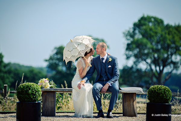 A happy couple taking a moment in the beautiful grounds at Gaynes Park barn wedding venue in Essex | CHWV