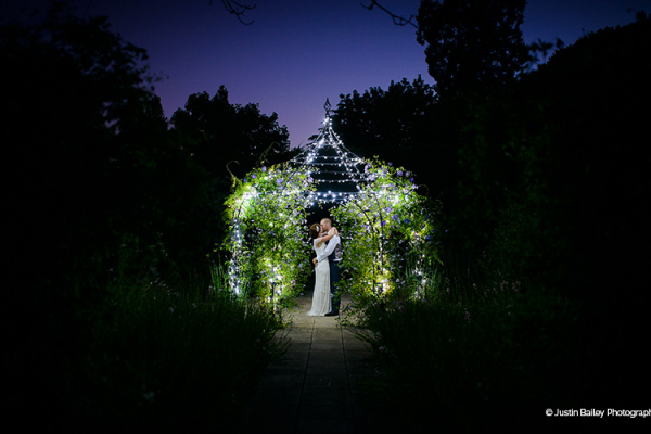 The Garden Pavilion lit up in the evening at Gaynes Park barn wedding venue in Essex | CHWV