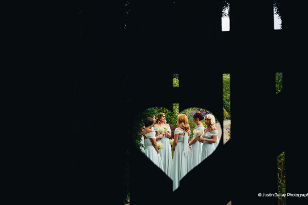 Through the heart gate in the beautiful grounds at Gaynes Park barn wedding venue in Essex | CHWV