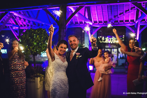 Sparklers in the evening at Gaynes Park barn wedding venue in Essex | CHWV