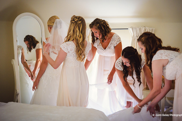 Bride and her bridesmaids getting ready at Gaynes Park barn wedding venue in Essex | CHWV