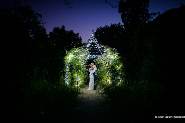 The Pavilion lit up with fairy lights at Gaynes Park barn wedding venue in Essex | CHWV