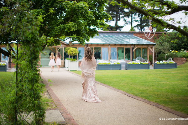Bridesmaids walking down the aisle at Gaynes Park barn wedding venue in Essex | CHWV