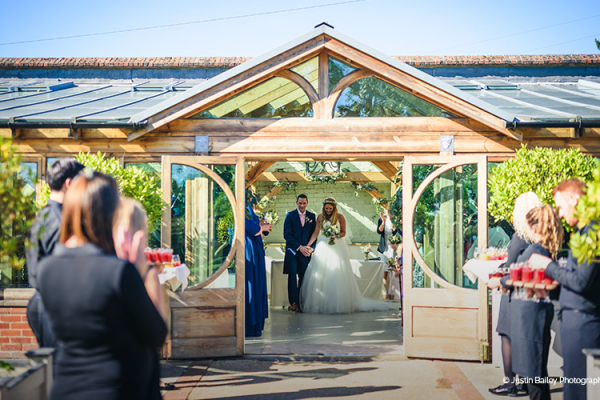 Just married in The Orangery at Gaynes Park barn wedding venue in Essex | CHWV