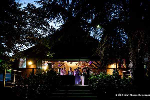 The barn in the evening at Gorcott Hall wedding venue in Worcestershire | CHWV