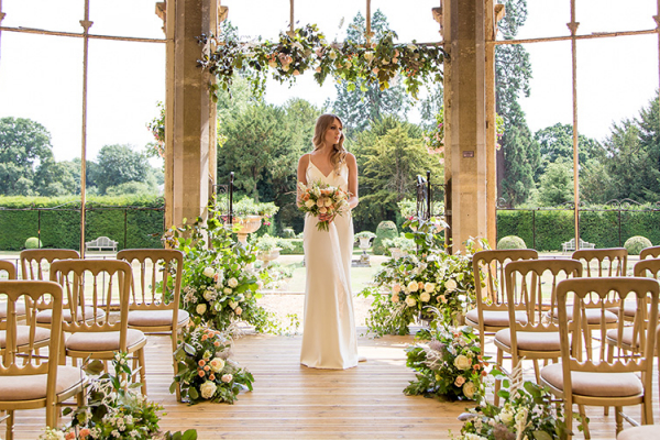 A bride in The Otangery at Grittleton House wedding venue in Wiltshire | CHWV