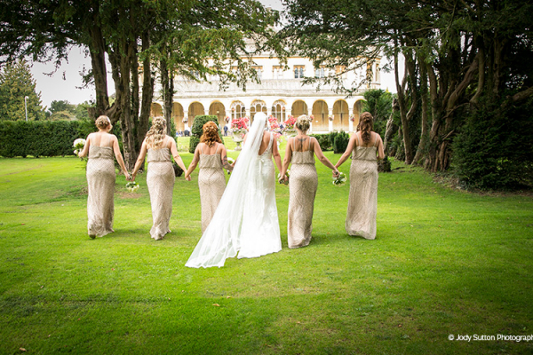 A bride and her bridesmaids at Grittleton House wedding venue in Wiltshire | CHWV