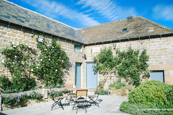 The courtyard at Healey Barn wedding venue in Northumberland in glorious sunshine | CHWV