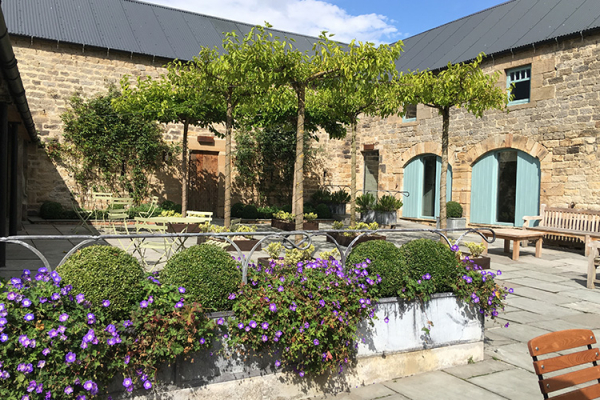 The lovely courtyard at Healey Barn wedding venue in Northumberland in glorious sunshine | CHWV