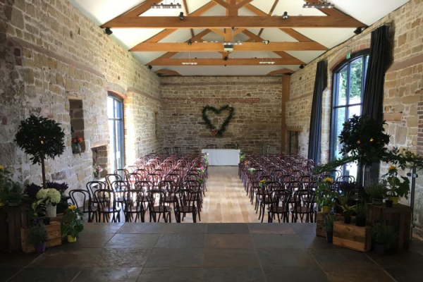 Set up for a wedding eremony at Hendall Manor Barn wedding venue in East Sussex | CHWV
