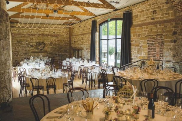 Set up for a wedding breakfast at Hendall Manor Barn wedding venue in East Sussex | CHWV