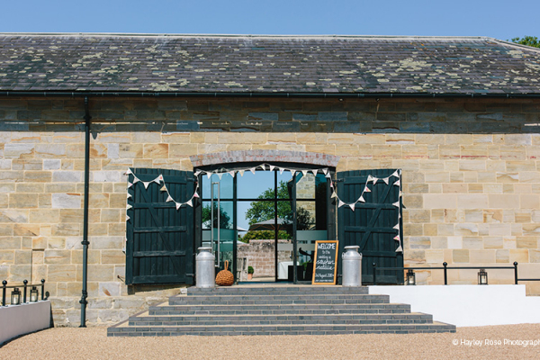 The barns and courtyard at Hendall Manor Barn wedding venue in East Sussex | CHWV