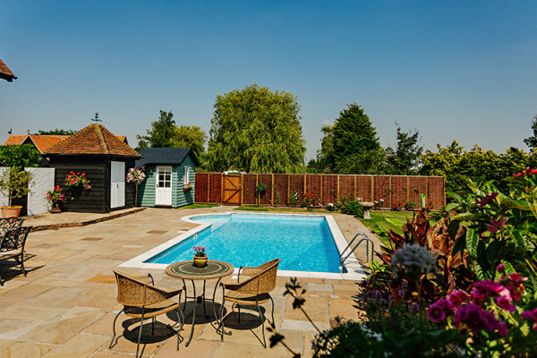 The outdoor pool at High House Weddings wedding venue in Essex | CHWV