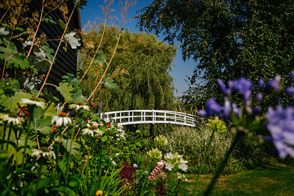 The bridge and gardens at High House Weddings wedding venue in Essex | CHWV