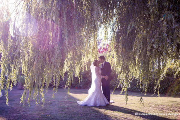 A happy couple in the grounds at High House Weddings wedding venue in Essex | CHWV