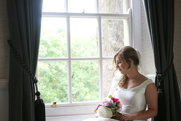 A bride getting ready at Holbrook Manor country house wedding venue in Somerset | CHWV