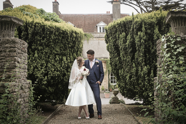 A couple taking a moment at Holbrook Manor country house wedding venue in Somerset | CHWV