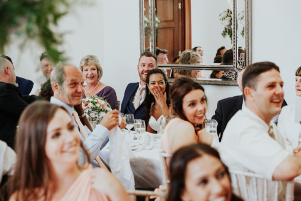Guests enjoying the speeches at Holbrook Manor country house wedding venue in Somerset | CHWV