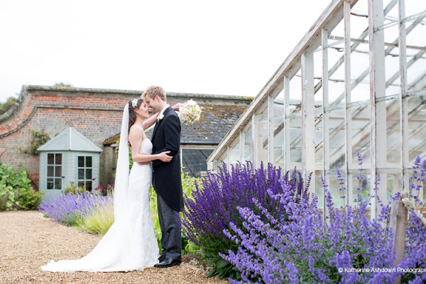 A couple taking a moment in The Walled Garden at Holkham Hall wedding venue in Norfolk | CHWV