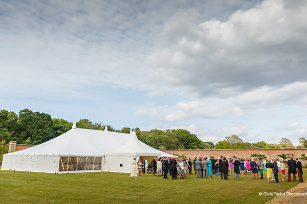A drinks reception outside the marquee at Holkham Hall wedding venue in Norfolk | CHWV