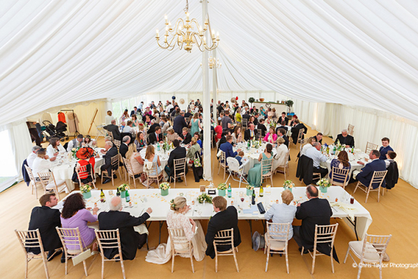 A wedding breakfast in the marquee at Holkham Hall wedding venue in Norfolk | CHWV