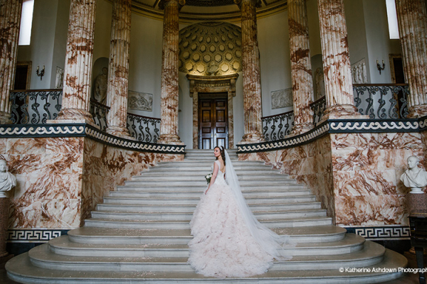 A beautiful bride in The Marble Hall at Holkham Hall wedding venue in Norfolk | CHWV
