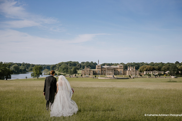 Happy couple taking a walk in the grounds at Holkham Hall wedding venue in Norfolk | CHWV