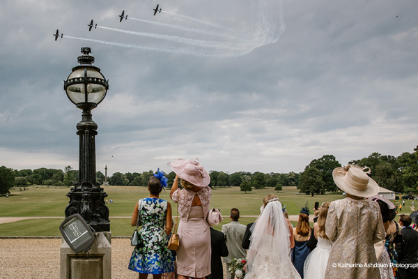 Air display wowing the wedding party at Holkham Hall wedding venue in Norfolk | CHWV