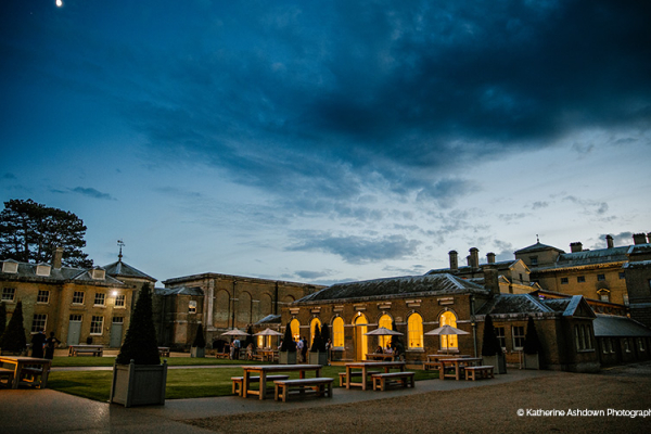Holkham Hall wedding venue in Norfolk lit up at dusk | CHWV