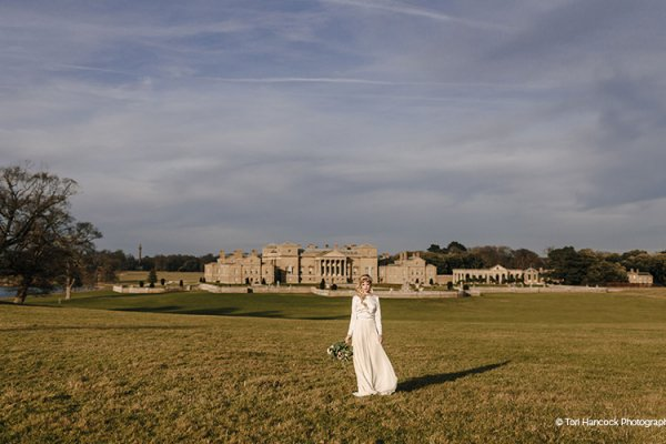 A bride enjoying the beautiful grounds at Holkham Hall wedding venue in Norfolk | CHWV