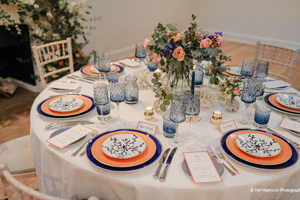 Blue and orange table decorations at Holkham Hall wedding venue in Norfolk | CHWV