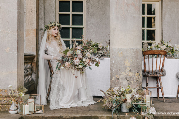 A bride outside the Temple at Holkham Hall wedding venue in Norfolk | CHWV