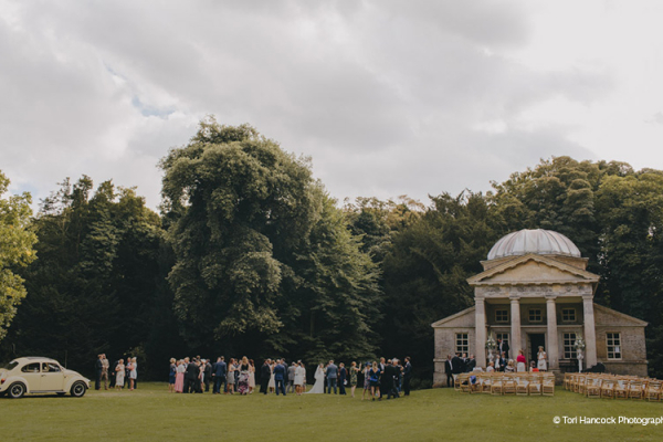 An outdoor ceremony at The Temple at Holkham Hall wedding venue in Norfolk | CHWV