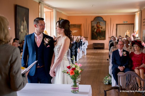 A wedding ceremony at Holme Pierrepont Hall wedding venue in Nottinghamshire | CHWV