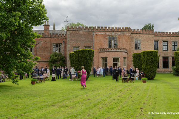 An outdoor drinks reception at Holme Pierrepont Hall wedding venue in Nottinghamshire | CHWV