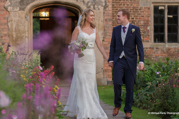 A couple taking a moment at Holme Pierrepont Hall wedding venue in Nottinghamshire | CHWV