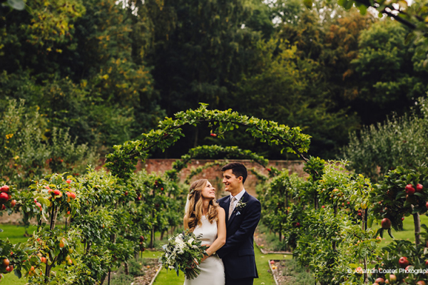 A couple taking a moment in the beautiful gardens at Homme House wedding venue in Herefordshire | CHWV